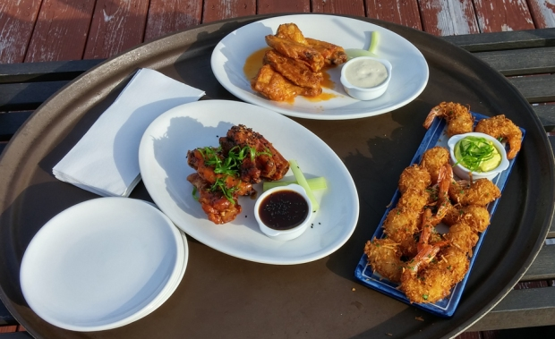 Wings two ways and coconut shrimp: all 75 cents each at happy hour. Photo by Catskill Eats