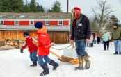 Kid-powered ice harvesting at the 2014 festival. Photo courtesy of Hanford Mills Museum.