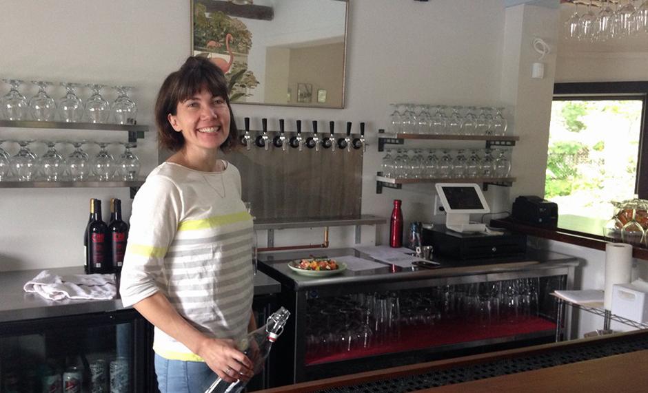 Megan Reynolds at the helm behind her new bar. Photo courtesy of Reynolds & Reynolds